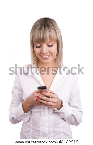 Smiling  is reading sms on the mobile phonee. Happy woman on the phone, must have been some pretty good news. Young female on cellphone.