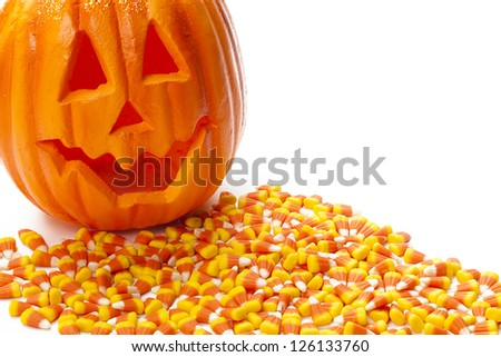 Smiling jack o lantern with candy corn on white background. - stock photo
