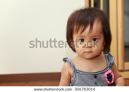 Smiling Japanese baby girl (0 year old)