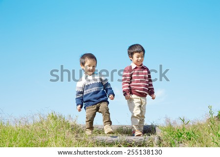 smiling Japanese brother - stock photo