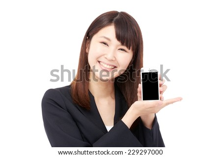 smiling Japanese businesswoman with the smart phone