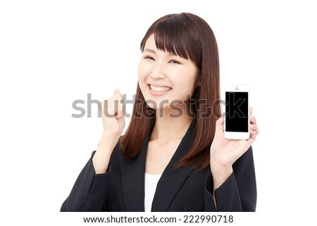 smiling Japanese businesswoman with the smartphone