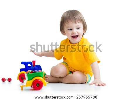 smiling  kid boy toddler playing with toys isolated - stock photo