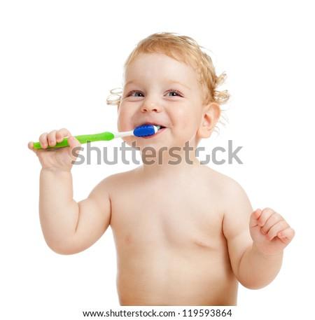 Smiling kid brushing teeth - stock photo