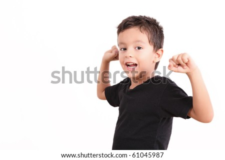 Smiling kid looking at the camera over white background