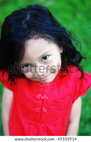 smiling kid with red shirt - stock photo