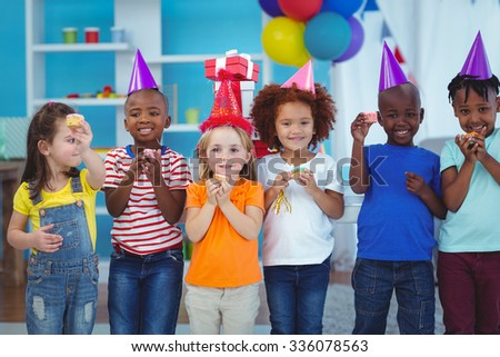 Smiling kids standing together at the birthday party