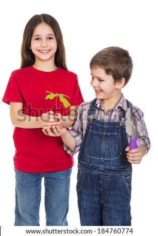 Smiling kids with oak sapling in hands, isolated on white - stock photo