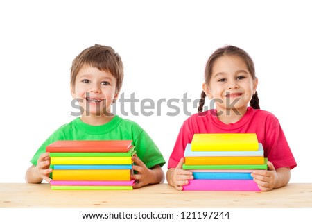 Smiling kids with pile of books, isolated on white - stock photo