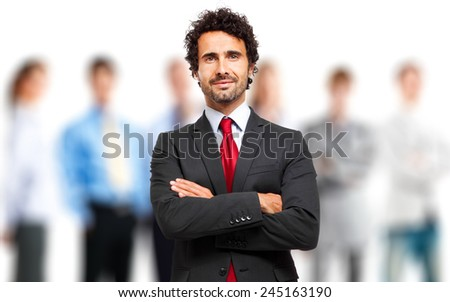 Smiling leader in front of a group of business people - stock photo