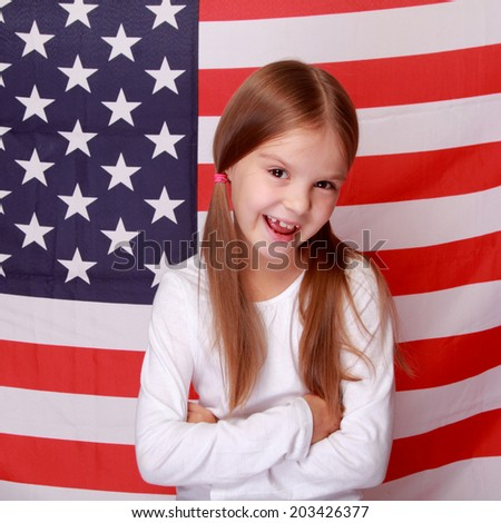 Smiling little American against the big American flag