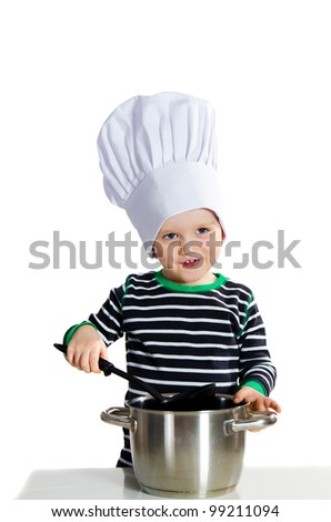 Smiling little baby boy in cook hat during cooking - isolated on white background