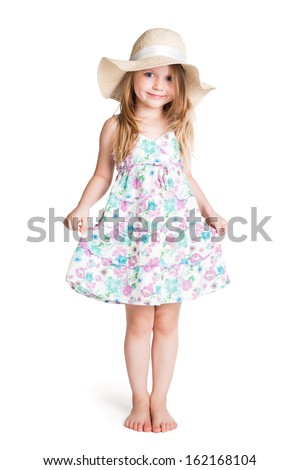 smiling little blonde girl wearing big white hat and dress  over white background  - stock photo