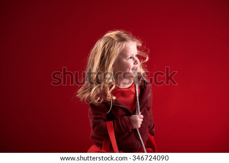 Smiling little blonde shopping. - stock photo