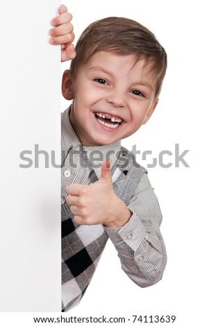 Smiling little boy holding empty white board - stock photo