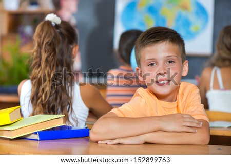 Smiling little boy in classroom at school