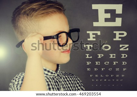 Smiling little boy in eyeglasses. Vision, health, childhood, ophthalmology and people concept.