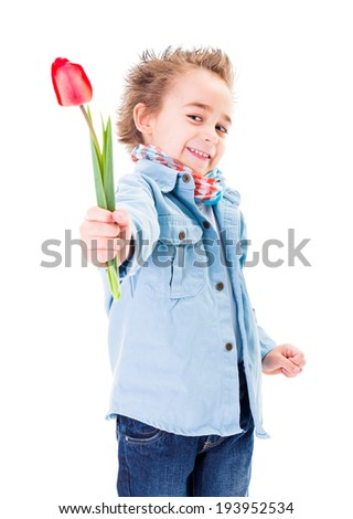 Smiling little boy offering a tulip isolated on white - stock photo