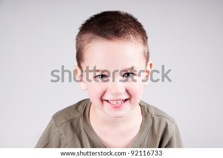 smiling little boy portrait. Child in studio - stock photo