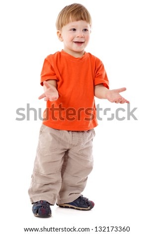 Smiling little boy standing with empty hands, isolated on white - stock photo