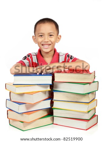 smiling little boy with his book. isolated on white background