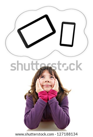 Smiling little child looking up at the devices - stock photo