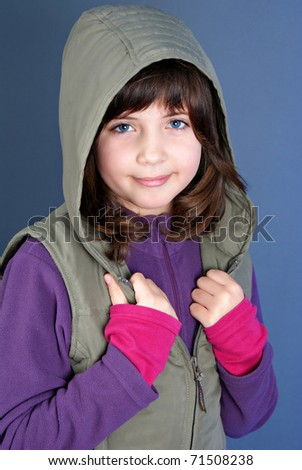 Smiling little child posing isolated on blue background - stock photo