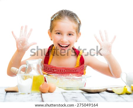 smiling little girl baking on kitchen and shows hands isolated on a white background - stock photo