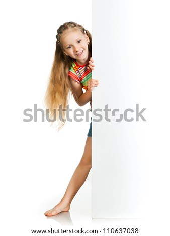 smiling little girl behind a white banner