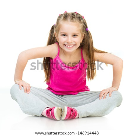Smiling Little girl gymnast on a white background - stock photo