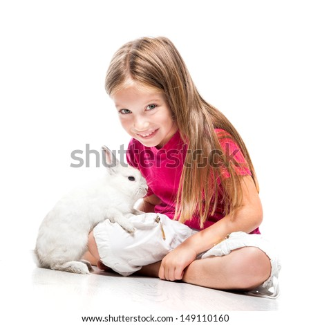 smiling little girl in a pink T-shirt with a  white rabbit