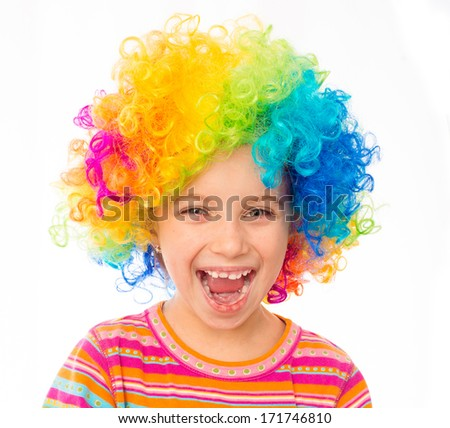 smiling little girl in clown wig isolated on white background - stock photo