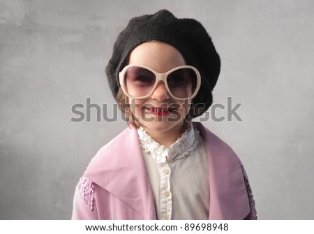 Smiling little girl in fashion clothes - stock photo