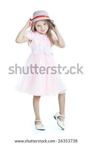 Smiling  little girl in pink dress and hat