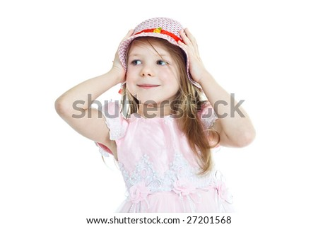 Smiling little girl in pink holding her hat - stock photo
