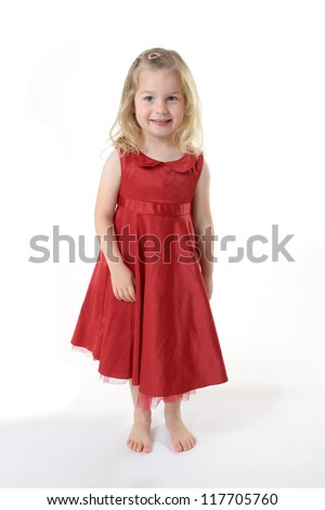 smiling little girl in red dress - stock photo
