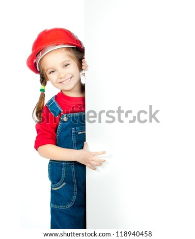 smiling little girl in the construction helmet with a white board - stock photo