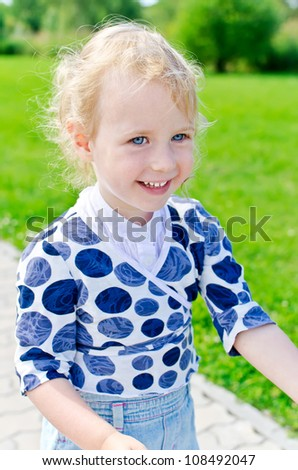 Smiling little girl in the park.
