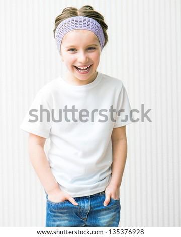 smiling little girl in white t-shirt - stock photo
