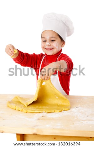 Smiling little girl kneading the dough for the cookies, isolated on white - stock photo