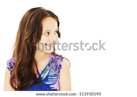 Smiling little girl looking at the copy space area. Isolated on white background - stock photo
