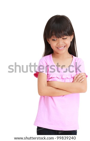 Smiling little girl looking down, Isolated on white - stock photo