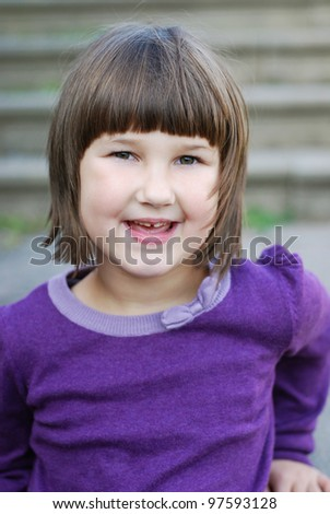 smiling little girl on stone steps