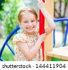 smiling little girl on the playground - stock photo