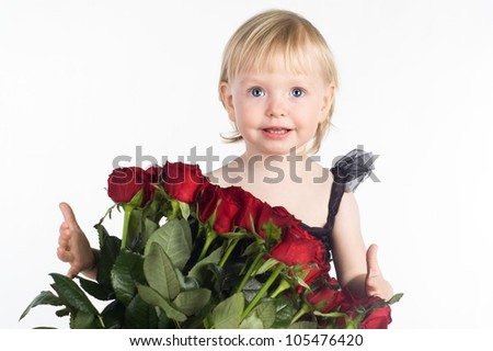 Smiling little girl receiving big bouquet of red flowers