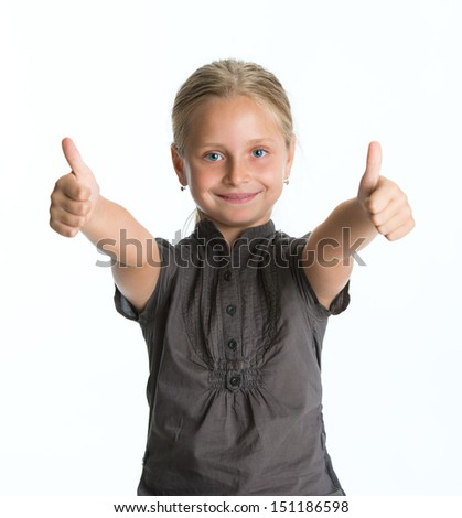 Smiling little girl  showing OK sign - stock photo
