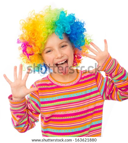 smiling little girl shows tongue and hands in clown wig isolated on white background - stock photo