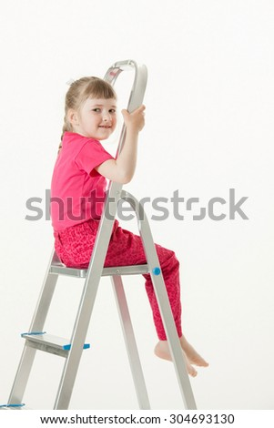 Smiling little girl sitting on the stepladder, white background - stock photo