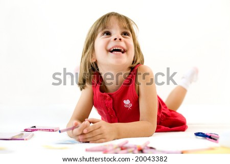 Smiling little girl with a crayon - stock photo
