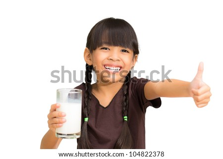 Smiling little girl with a glass of milk, Isolated on white - stock photo